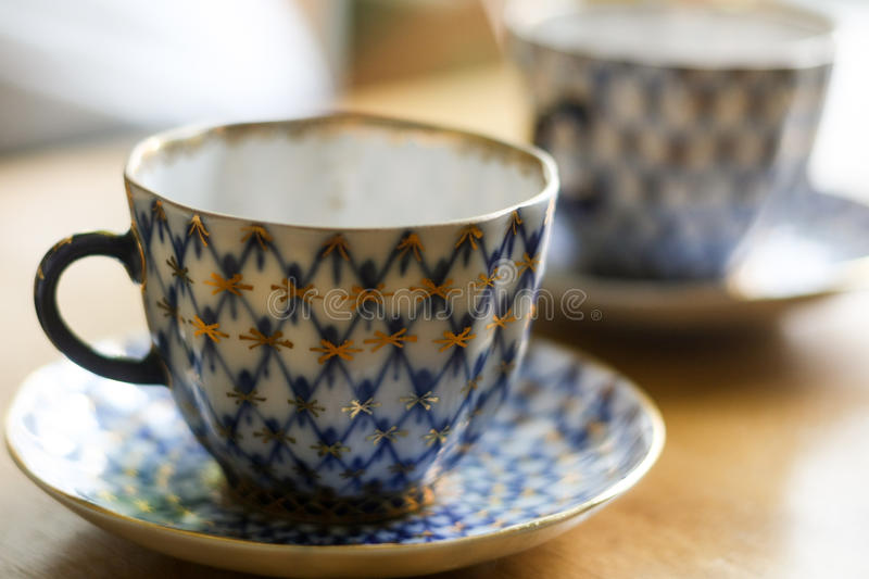 Coffee cup and saucer production of the Imperial (Lomonosov) Porcelain Factory. Branded cobalt mesh with gold ornament stock images