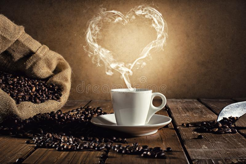Coffee cup with a smoke shaped as an hearth. Coffee cup over a wooden table with a smoke shaped as an hearth stock illustration