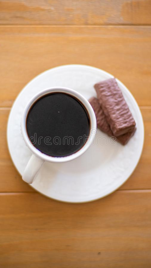 Coffee Cup with Snack on Coaster royalty free stock images