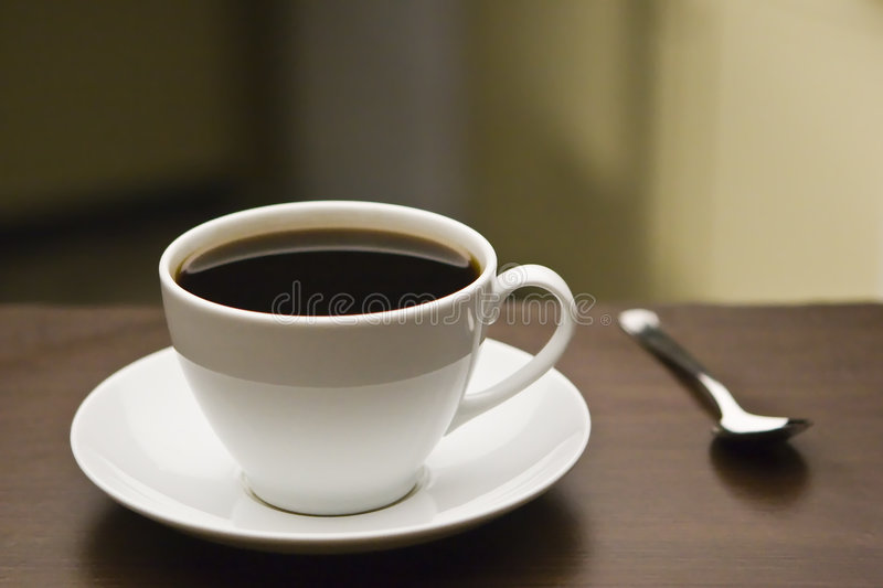 Coffee Cup and Spoon royalty free stock photos