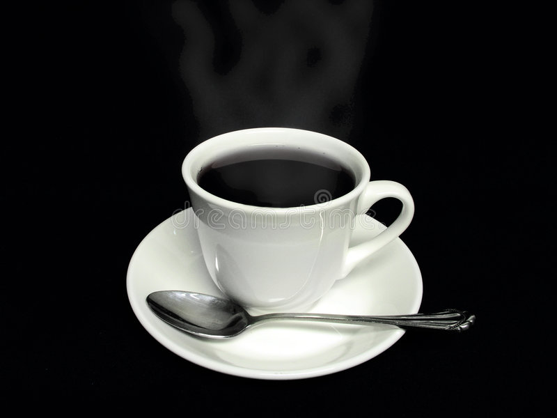 Coffee cup and spoon. Coffee service with a cup saucer and spoon stock photography