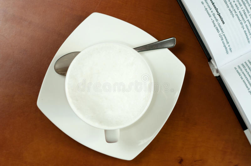 Coffee Cup With Spoon And Book Aside Stock Photo
