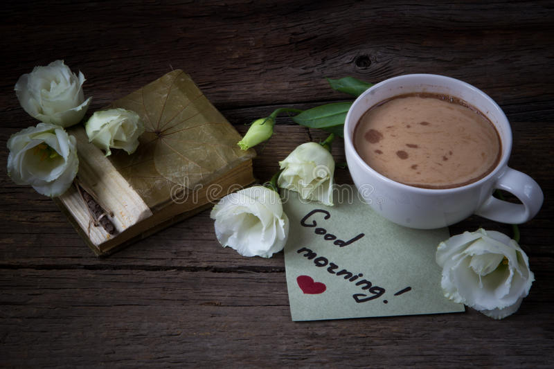 Coffee cup with spring flower lisianthus and notes good morning stock photos
