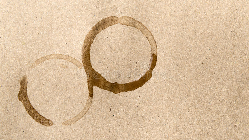 Coffee cup stain. Over brown background stock photography