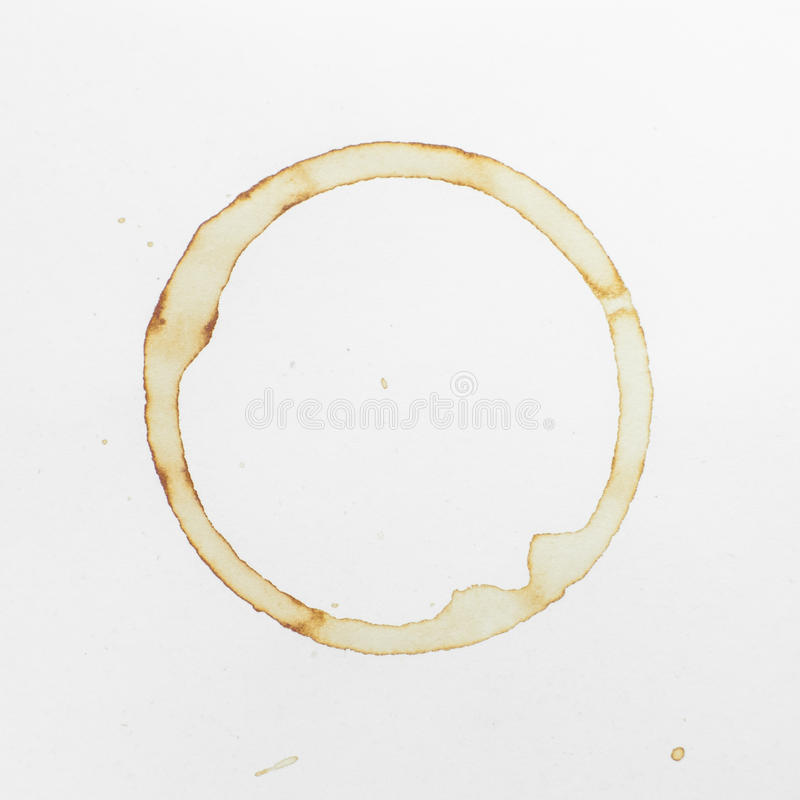 Coffee cup stain. On white paper royalty free stock photo