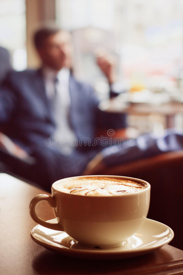 Coffee cup on the table. Coffee cup on the edge of the table royalty free stock image