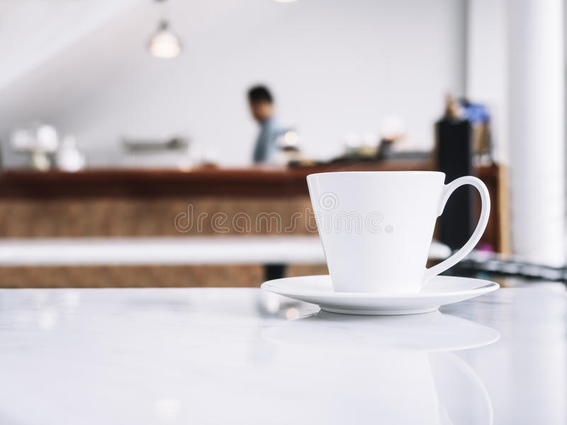 Coffee cup on table with blurred people in Restaurant shop cafe. Background stock images