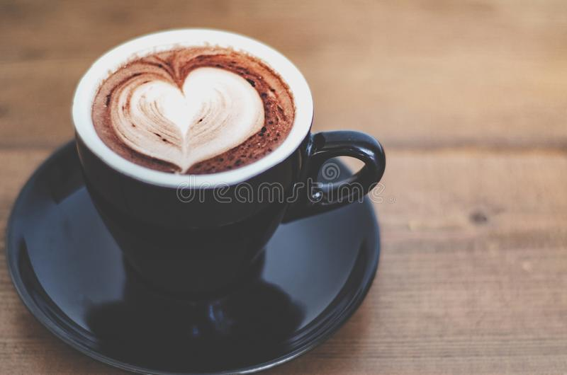 Black coffee cups placed on the table in the morning. stock photos
