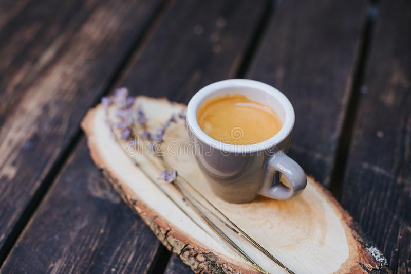 Coffee cup on table. Cup of hot latte coffee in the relaxing time. cup of coffee on wooden. Lavender. Aroma of lavender. Aroma of stock photo