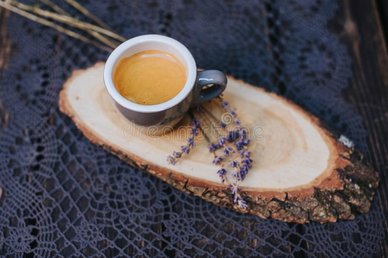 Coffee cup on table. Cup of hot latte coffee in the relaxing time. cup of coffee on wooden. Lavender. Aroma of lavender. Aroma of stock images