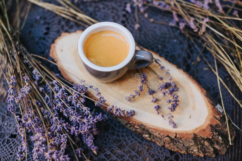 Coffee cup on table. Cup of hot latte coffee in the relaxing time. cup of coffee on wooden. Lavender. Aroma of lavender. Aroma of stock photography