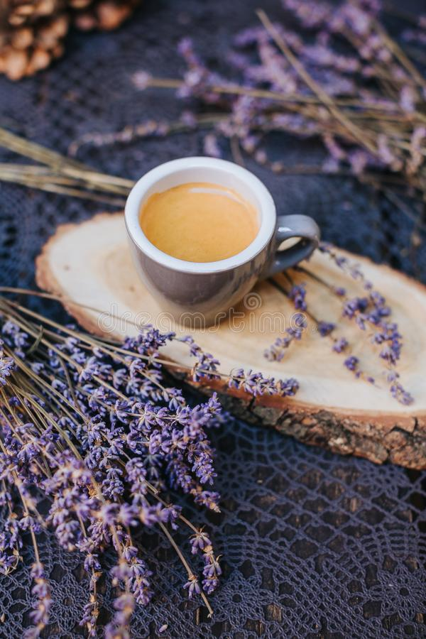 Coffee cup on table. Cup of hot latte coffee in the relaxing time. cup of coffee on wooden. Lavender. Aroma of lavender. Aroma of royalty free stock photos