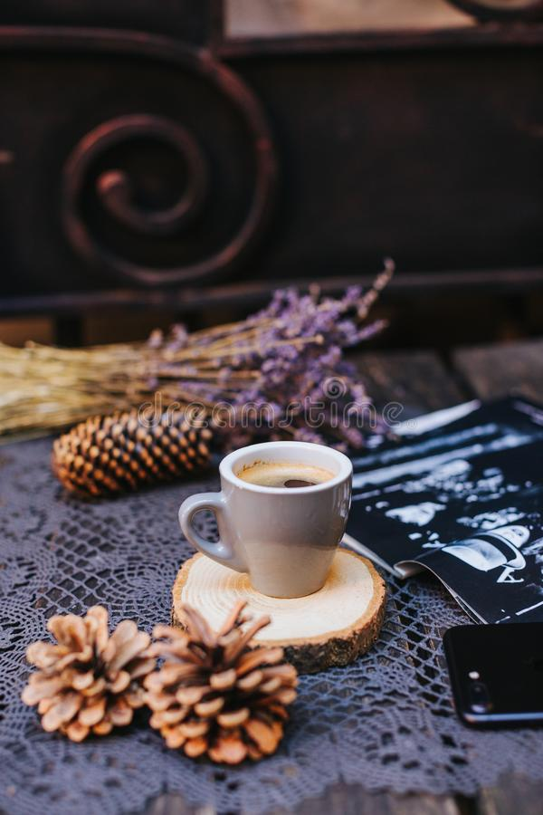 Coffee cup on table. Cup of hot latte coffee in the relaxing time. cup of coffee on wooden. Lavender. Aroma of lavender. Aroma of stock image