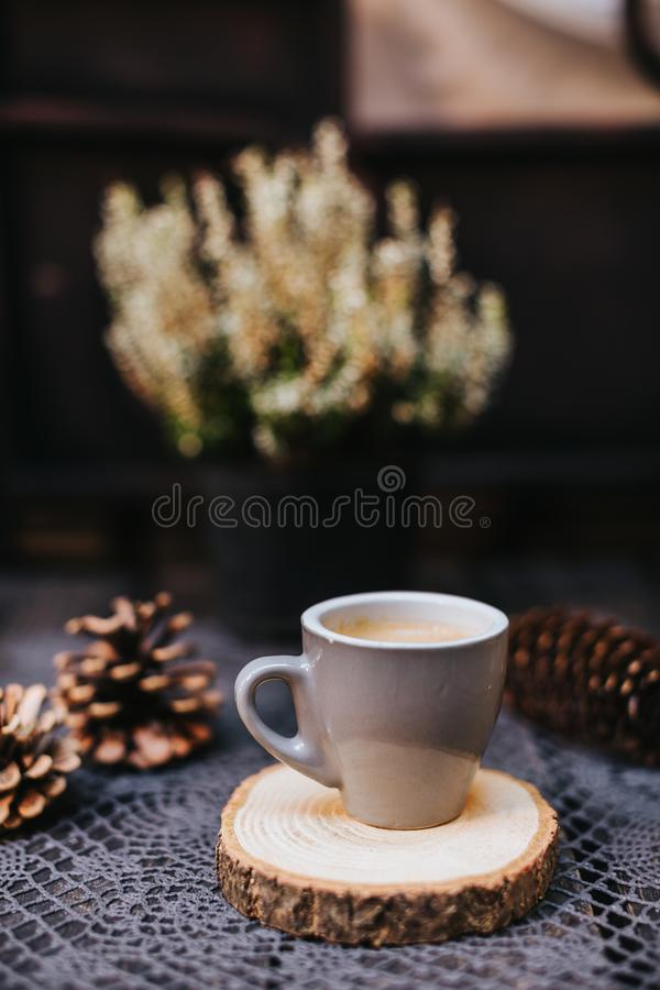 Coffee cup on table. Cup of hot latte coffee in the relaxing time. cup of coffee on wooden. Lavender. Aroma of lavender. Aroma of royalty free stock image