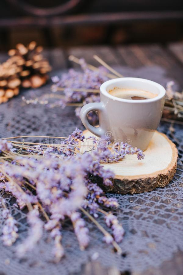 Coffee cup on table. Cup of hot latte coffee in the relaxing time. cup of coffee on wooden. Lavender. Aroma of lavender. Aroma of stock photos