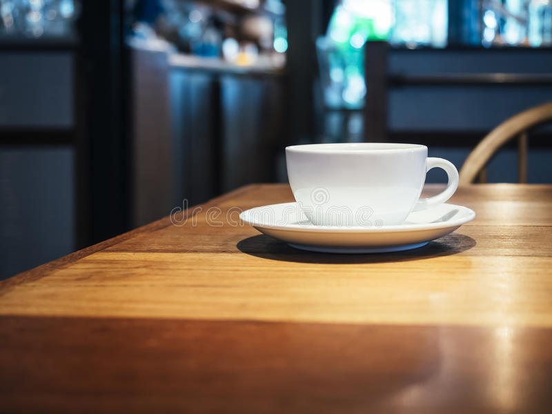 Coffee cup on table in Shop cafe Interior. Background stock images