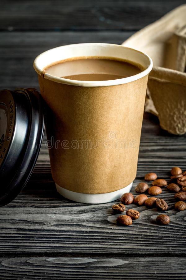 Coffee cup take away at wooden background. Coffee cup take away at dark wooden background stock photography