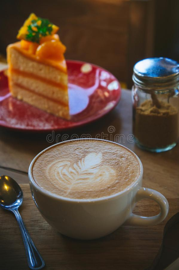 Coffee cup and tasty cake on wood table and Blank paper waiting for ideas , coffee time work stock photos