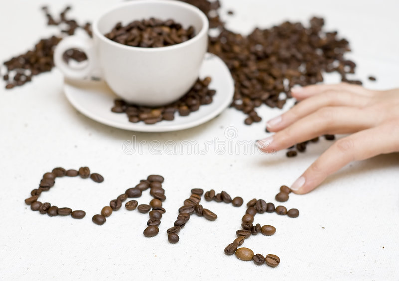 Coffee cup text - 'cafe' royalty free stock images