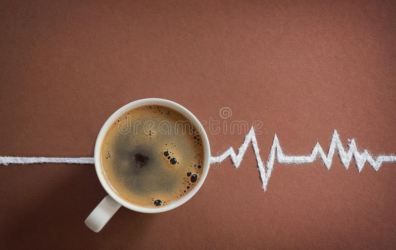 Coffee cup top view and heart beats cardiogram stock photography