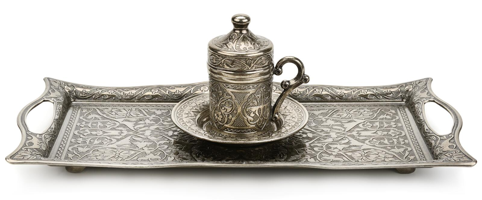 Coffee cup and tray with arabic decoration isolated on a white background. Wide photo royalty free stock photography