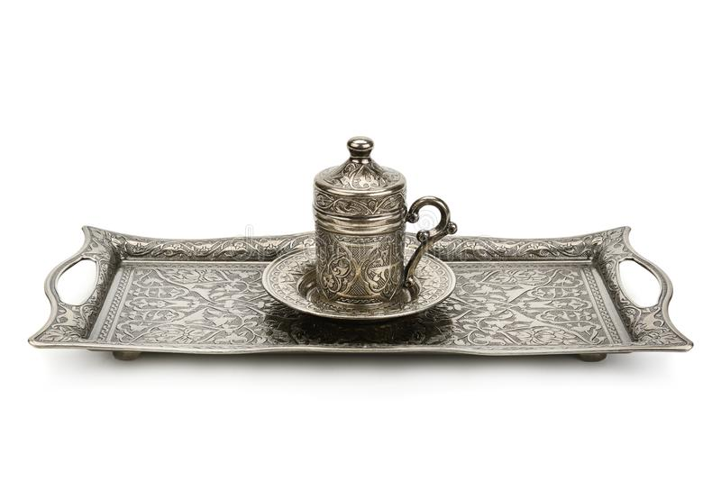 Coffee cup and tray with arabic decoration with metal cup and dish on a white background royalty free stock images