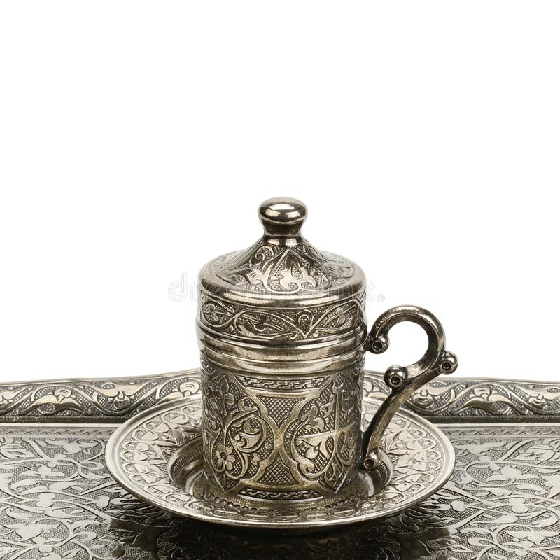 Coffee cup and tray with arabic decoration with metal cup and dish isolated on a white background. Free space for text royalty free stock photos