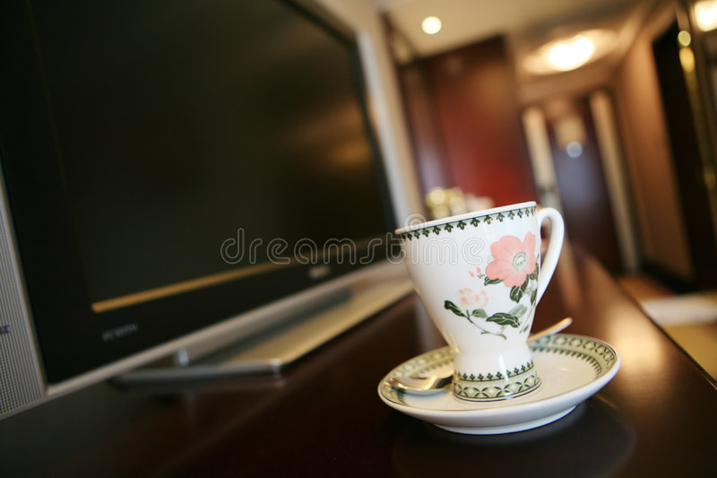 Download Coffee cup beside TV stock photo. Image of screen, technology - 7220554