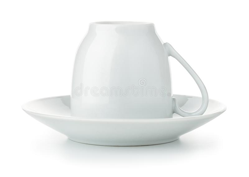 Coffee cup upside down on saucer royalty free stock photos