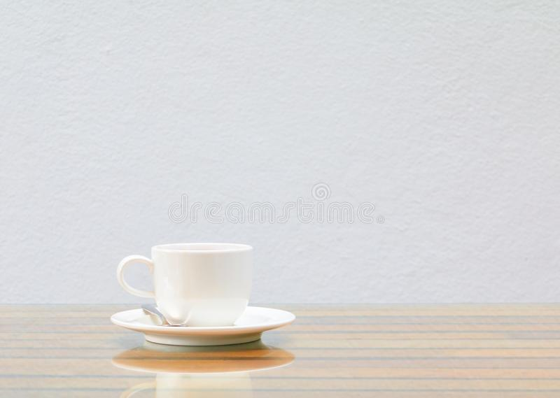 Coffee cup white On the glass table wooden and a cement wall background. Copy space stock photos