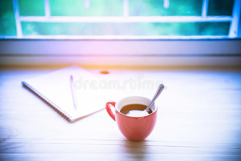 Coffee cup on wood stock photography