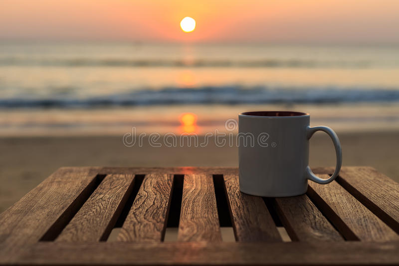 Download Coffee Cup On Wood Table At Sunset Or Sunrise Beach Stock Image - Image of & Coffee Cup On Wood Table At Sunset Or Sunrise Beach Stock Image ...