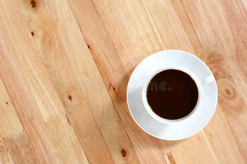 Coffee cup on wood table royalty free stock image