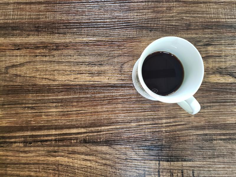 Coffee cup on wooden table, black coffee royalty free stock photo