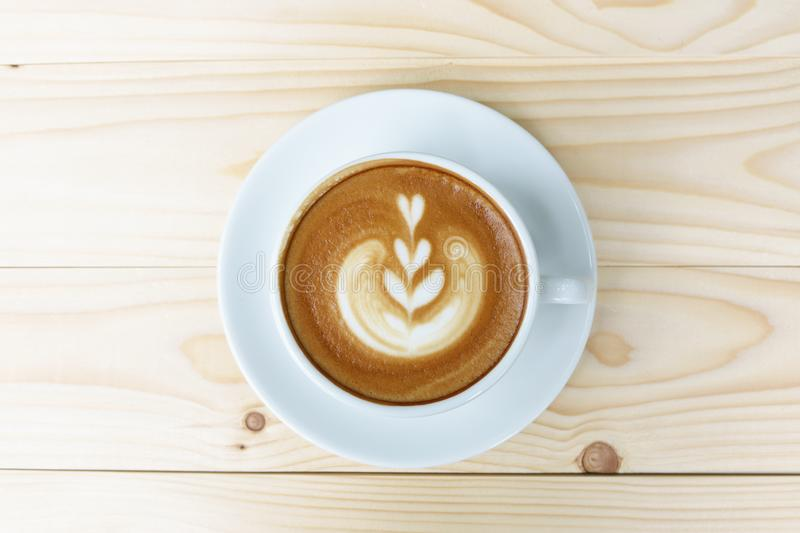Coffee cup with on wooden table stock image