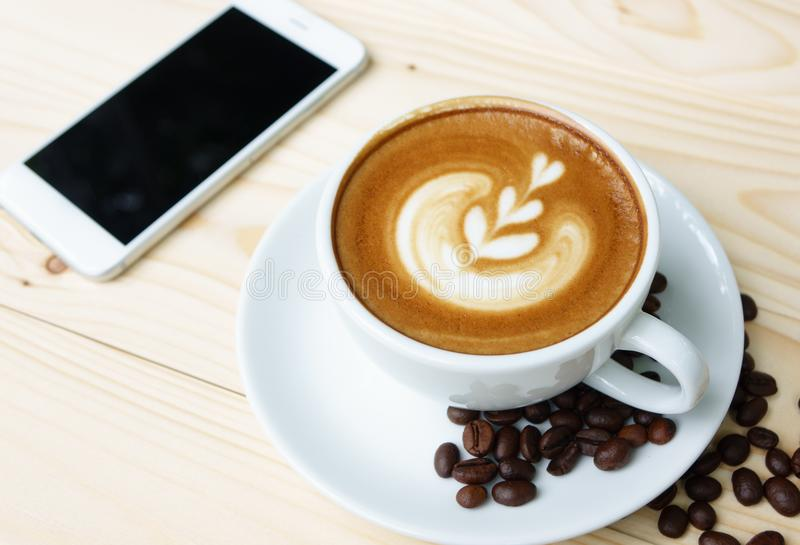 Coffee cup with on wooden table stock photo
