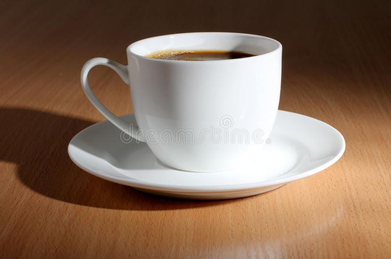 Coffee cup on woods