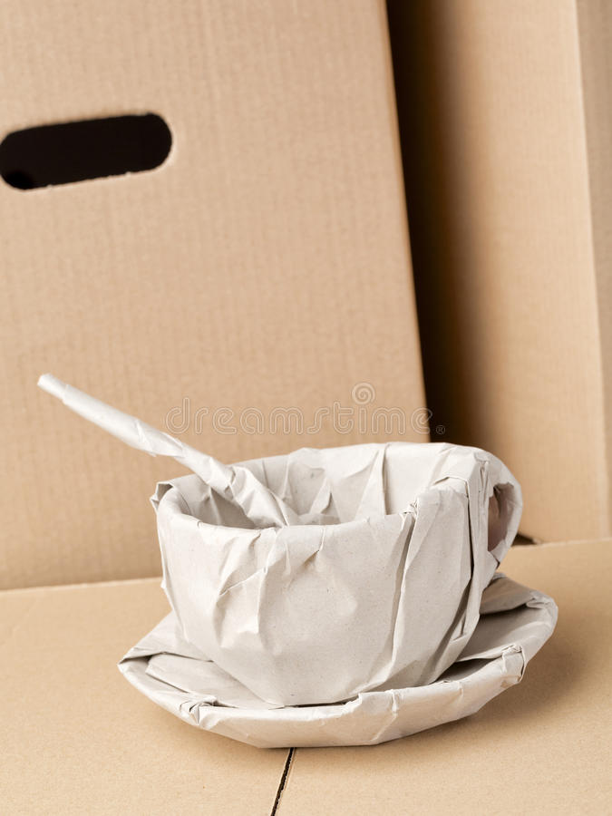 Coffee Cup Wrapped in Packaging Paper royalty free stock photos