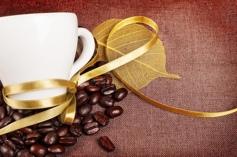 Download Coffee Cup With Yellow Ribbon Stock Image - Image of ribbon, sackcloth: 26845731