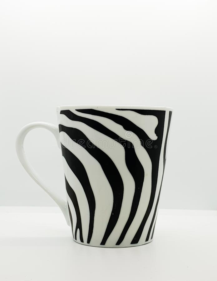 A coffee cup with zebra line pattern. Zebra patters stock photos