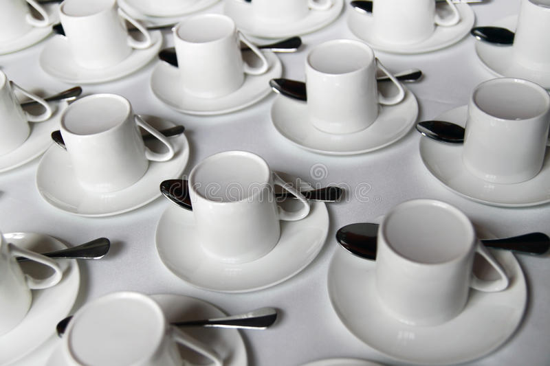 Coffee cups. Pile of Coffee cups with teaspoons stock photography