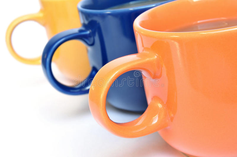 Coffee cups. Three multicolored coffee cups on white background royalty free stock image