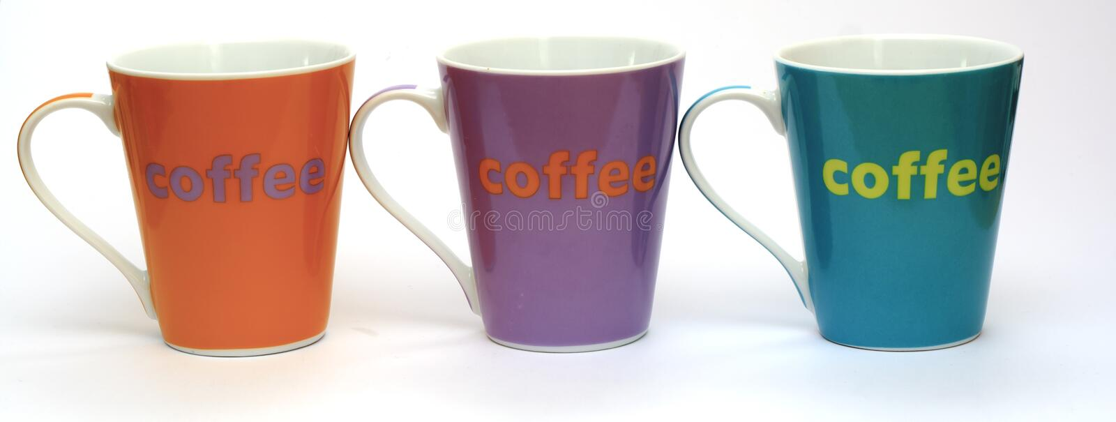 Coffee cups. Coloured coffee cups in a line royalty free stock photography