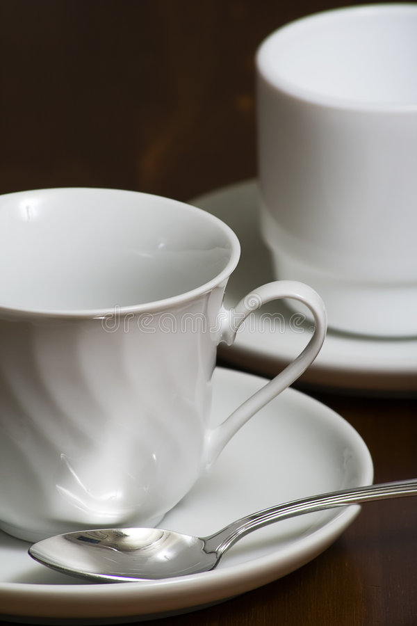 Coffee Cups. Empty white coffee cups with saucers with a shallow DOF royalty free stock photos