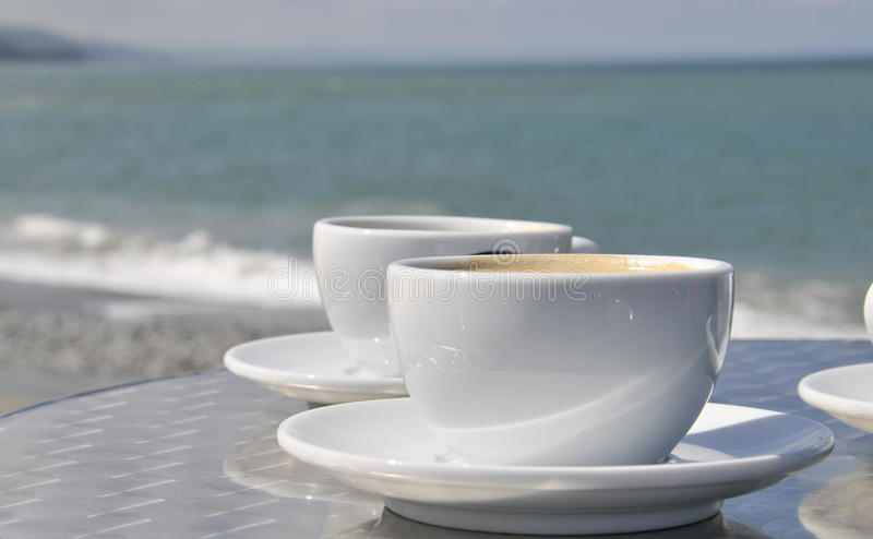 Coffee cups and beach stock photos