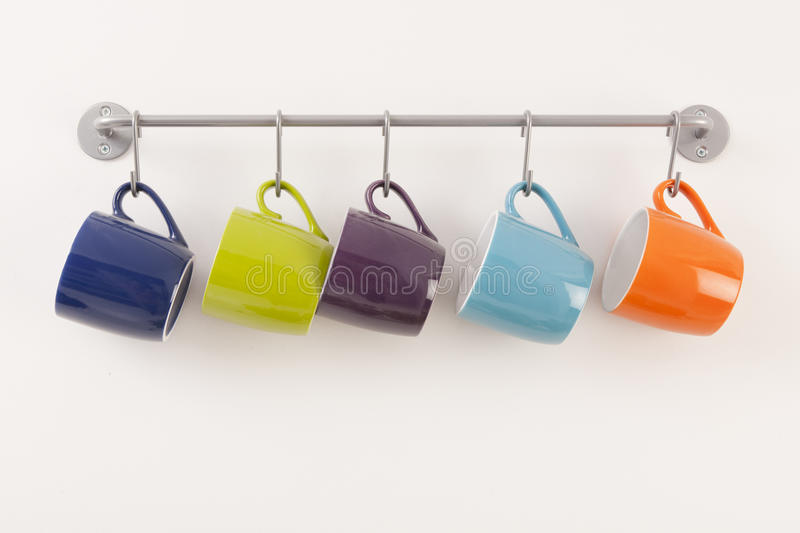 Colorful Cups On Metal Rack Royalty Free Stock Image