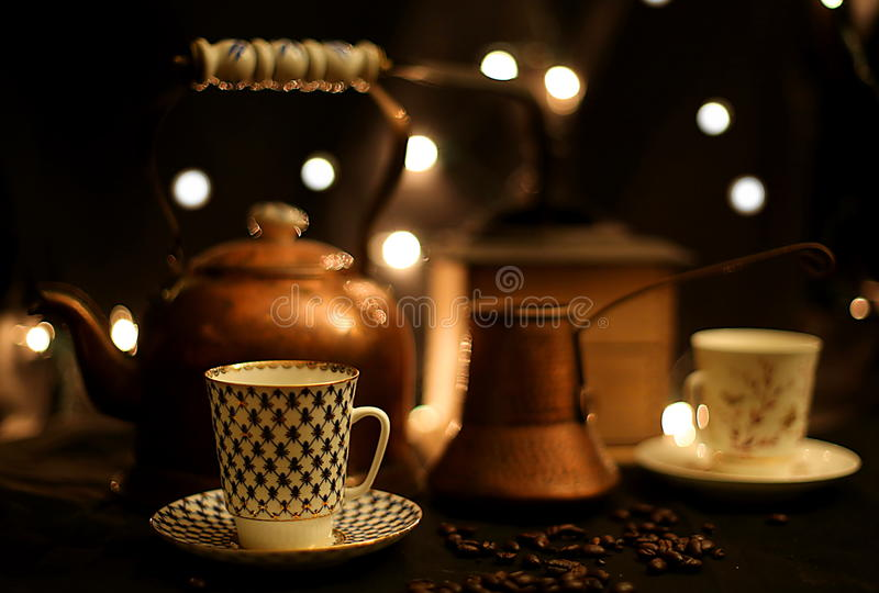 Coffee Cups and Pots. Still life with porcelain coffee cups, pots, and grinder royalty free stock photo