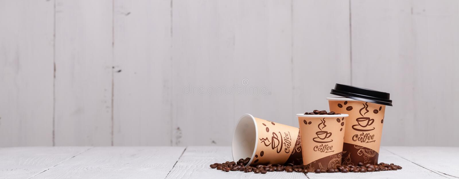 Coffee cups on wooden table for site header royalty free stock photos