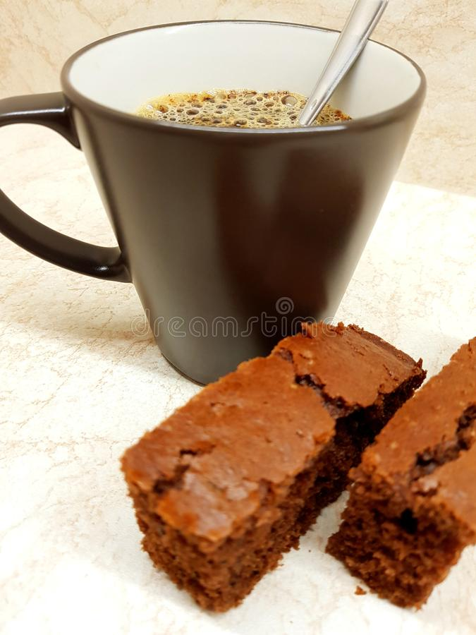 Coffee and dessert. On the kitchen, two pieces of brown gingerbread stock photo