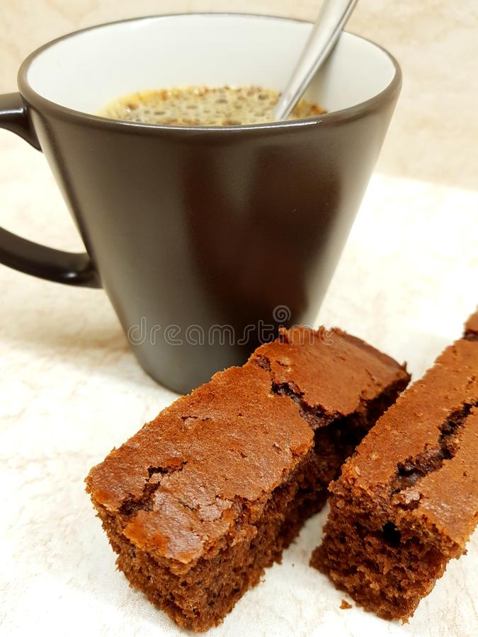 Coffee and dessert. On the kitchen, two pieces of brown gingerbread royalty free stock image